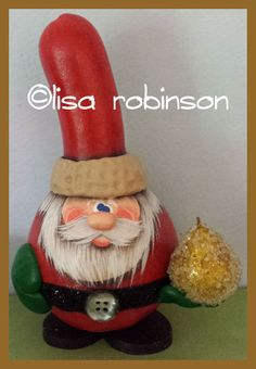 This is gifting Santa! He is a sweet little fella painted on a spoon gourd. He measures 5 1/8 tall and 8 around his sweet little self!! He has his