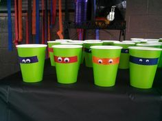 Teenage mutant ninja turtle party cups.  Grossgrain ribbon with googly eyes!  Also used the same ribbon and googly eyes on square lime green plates!  And wrapped black cutlery in lime green napkins and used the ribbon and eyes on them too.....super cute!!!