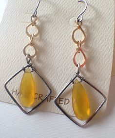 Check the store front for coupon codes! http://www.etsy.com/shop/anikosandor?ref=pr_shop_more    Free shipping! Modern shapes: diamond frame and honey yellow chalcedony beads are combined in these simple and elegant earrings. The silver and gold wires create a beautiful contrast around the yellow beads. They are tarnished and hand polished.    - 3 with ear wires  - 1 3/4 wide at the widest point  - silver and gold-filled wire  - honey yellow chalcedony beads    I...