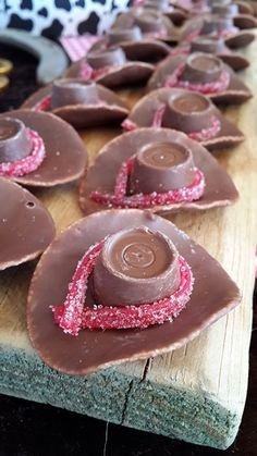 Cowboy hats + chocolate = LOVE! Use pull apart twizzlers instead of punch straws it is much easier