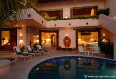 VILLA MCFUEGO -  This Puerto Vallarta  beachfront villa is located in Conchas Chinas on a small private sandy beach cove. Let the warm sun and balmy breezes beckon you to explore the endless wonders of Puerto Vallarta in this luxury Mexico villa rental. The interior of this Puerto Vallarta villa rental features over 4,000 square feet with an additional 2,000 square feet of terraces and beautiful pool overlooking Banderas Bay.