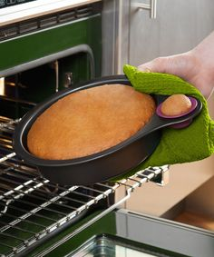 The nibble is a traditional cake pan with a fun twist. There's a mini silicone cup alongside the carbon steel pan, so bakers can have a little bite of cake long before dessert is served. Brilliant! 9'' W x 3'' H x 12'' DCarbon steel / siliconeDishwasher safeImported