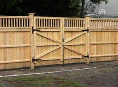 double swing wood fence gate Spring loaded rollers to help move