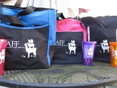 Tote bags and double wall tumbers, Southeastern Animal Fiber Fair