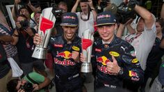 Race winner Daniel Ricciardo (AUS) Red Bull Racing and Max Verstappen (NED) Red Bull Racing celebrate with the trophies at Formula One World Championship, Rd16, Malaysian Grand Prix, Race, Sepang, Malaysia, Sunday 2 October 2016. © Sutton Images