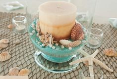 Beach wedding centerpiece idea I like the aqua color, and that it is flower-less.  I would include sand dollars.