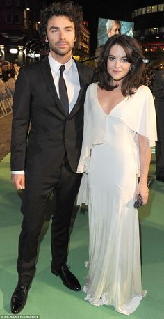 Aidan Turner is seen here with girlfriend of three years, Sarah Greene, who is also an act...