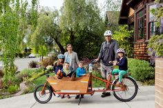 Families Ditch Cars for Cargo Bikes - NYTimes.com - links to several different types.  Hmm.  I'd need to be a much more confident city cyclist.....