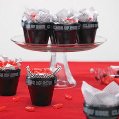 Wrap graduation ribbon around the lip of each BRIDES® clay pot, cut and secure using adhesive dots.    Place the tissue paper from the BRIDES® clay pot favor kit in the bottom of the clay pots with the print facing downwards.    Fill the clay pots with your candy of choice.    Repeat Steps 1-3 until desired quantity is reached.