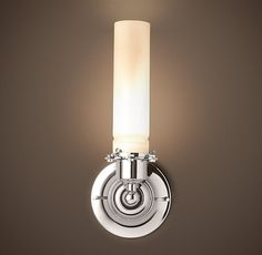 RH's Edison Milk Glass Sconce:Fitted with a valve and a striker and a shade to protect the flame, turn-of-the-century gas lamps were the forerunners of both 20th-   century electrification and contemporary industrial design. Our replica features a white glass shade that has the look of vintage milk glass.  $134