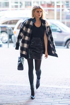 Hot to trot:Charlotte McKinney strutted her way down Wall Street in New York on Thursday, not letting a chill in the air out a damper on her fierce fashion