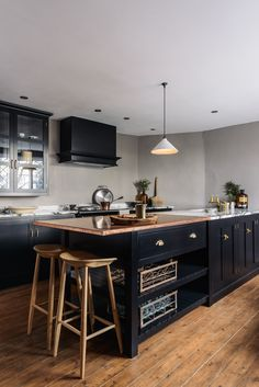 A beautiful deVOL Kitchen featuring black painted cupboards and deep grey walls