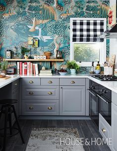 For a bold move in the kitchen, eschew backsplash tiles and opt for dramatic wallpaper, like this fairytale-inspired mural by Zoffany. | Photographer: Michael Graydon | Designer: Sarah Hartill