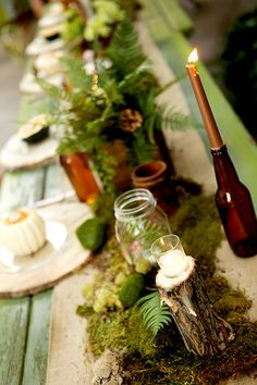 moss, jars, upcycled beer bottles for candle holders and wood rounds for chargers -- all for a great woodsy inspired wedding