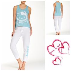 Sale Hello Kitty Pajamas M, L was $27 Combining a sporty look with the love of the cutest cat, this Women's Hello Kitty Electric Glow Tank/Pant Pajama Set - Blue/White is sure to please the active girly-girl. Made of a comfy cotton blend, this set, which features Hello Kitty front and center in a glowing cast, stands out as an adorable lounge outfit doubling as sleepwear. The blue racerback tank top in this set of pajamas has a relaxed fit that pairs perfectly with the coordinating fitted…