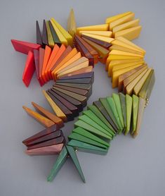 Vintage Bakelite colour chips in their oxidized (yellowed) state that we're familiar with ... not the original colors.