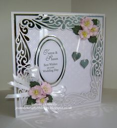 This must be the hardest combination to photograph, White Pearl and Silver Foil - Wedding Card using Creative Expressions Gemini Dies Pyxis and Complete Petal Leaves with Joy Craft Ovals and Hearts.