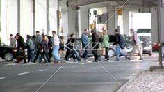 view of people crossing road. - Video of people crossing road at crossroad.