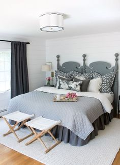 Master bedroom makeover with planked walls painted in Farrow & Ball All White and soothing neutral decor. A HUGE change from the before pics in this post!