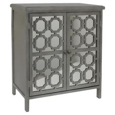 Give your den or dining room a distinctive touch with this captivating cabinet, highlighted by 2 mirrored doors with artful geometric overlays.