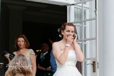 A surprise telephone call from abroad. Summer wedding at the Gorse Hill Hotel in Woking, Surrey.  Photography by Penny Young Photography.
