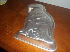 1987 Godzilla Wilton Cake Pan  or T-Rex Dinosaur Wilton Cake Pan or Partysaurus. $9.00, via Etsy.
