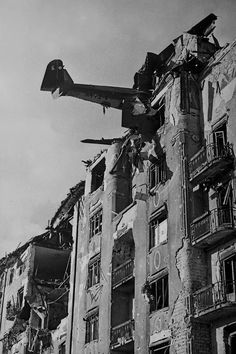 Khaldei's Wartime Photographs Yevgeny Khaldei: On December a plane crashed into the roof of a residential building in Budapest.Yevgeny Khaldei: On December a plane crashed into the roof of a residential building in Budapest. World History, World War Ii, Berlin 1945, German Army, Military History, Historical Photos, Old Photos, Wwii, Image