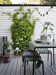 Home tour: Janniche Bergstrom — 91 Magazine - lovely outside space in scandi style with garden furniture and festoon lighting Outdoor Spaces, Outdoor Living, Outdoor Walls, Scandinavian Garden, Scandi Garden, Snow In Summer, Garden Spaces, Garden Inspiration, House Tours