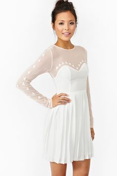 Whimsical white dress with nude mesh top and triangle detailing. Would be super cute with colorful pumps and clutch!