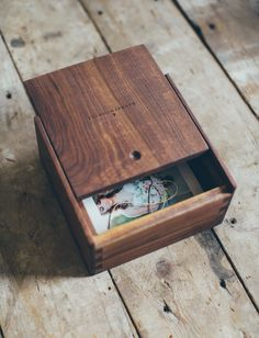 The Evan by HH Boogie. A 6.75 x 4.25 sized box for your  smaller prints. Looks beautiful (and inconspicuous!) as a part of your home decor. ($250)