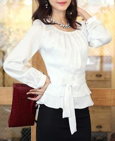 blouse view with ruffled peplum