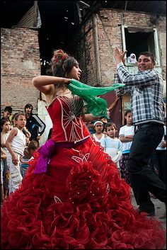 Turkish gypsy wedding, bride in her traditional red dress dancing, Ankara, 2010s.