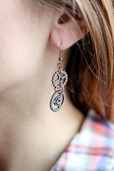 "These amazing ""Steampunk Inspired"" hand crafted oxidized brass gear earrings are…"