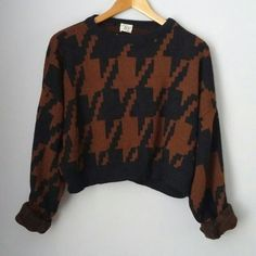 Vintage crop Houndstooth sweater EXCELLENT vintage condition! Material tag missing but assuming acrylic or cotton blend. Not scratchy. 80s 90s Brown and black crop style sweater. Big baggy sleeves. Armpit to armpit approx we inches. Approx 17 inches shoulder to bottom. Measurements taken laid flat relaxed.  Bundle for best deals!! Hundreds of items available for discounted bundles- items starting as low as $5! You can get lots of items for a low price and one shipping fee!  Follow on IG…