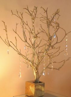 Etsy Vendor madamMANZANITA.  Add huge arrangement of flowers to hide base.  Add sprays of fresh flowers among branches.  Could hang pics of bride & groom?  Could use as wishing tree?