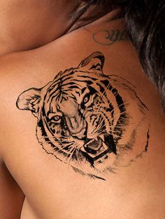 This highly detailed black and white tiger tattoo represents strength, power and danger. This cool tattoo looks awesome as a shoulder or chest tattoo, a leg or arm tattoo or placed anywhere you like!