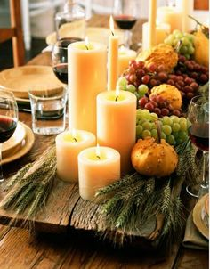 (Well worn board as base of centerpiece. For a smaller arrangement try a wooden cutting board.)