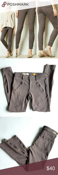"""Anthropologie Zippered Ankle Moto Pants By Pilcro.  Two back pockets, two faux zipper pocket up front, zipper closure and single button,  belt loops,  zippered ankles. 92% cotton,  7% polyester 1% spandex.  14"""" waist,  8"""" rise,  28"""" inseam.  In great condition. Color is brownish gray. Anthropologie Jeans Skinny"""