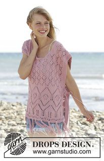 "Rose Smile - Knitted DROPS poncho with lace pattern and fringes in ""Paris"". Size: S - XXXL. - Free pattern by DROPS Design"