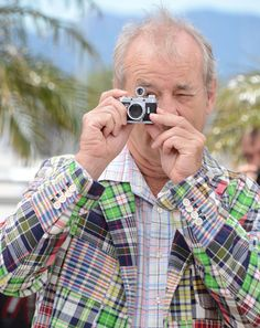 I love everything about this photo. Bill Murray in a rad jacket with a mini camera!