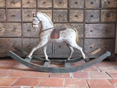 Decorative carved and painted rocking horse ...... beautiful..... look at the chest in the background