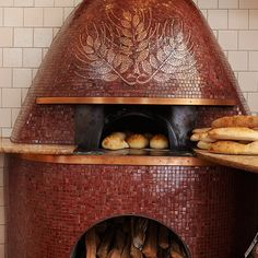 """Spacca Napoli; Chicago - The beehive-shaped oven at this Neapolitan pizzeria was built on-site by 3rd- & 4th-generation members of an artisanal oven-making family from Naples—owner Jonathan Goldsmith keeps mum on the artisans' last name. """"It's a family secret,"""" he says. The wood-burning oven was modeled after the communal ovens of ancient Pompeii. Its mosaic of wheat is made with Venetian glass tiles & was inspired by an image of a coin in Le Antiche Monete di Neapolis, a book about the..."""