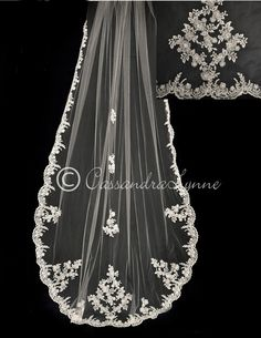 This is an elegant lace veil to cherish! The edge is slightly scalloped with high quality, sequined alencon lace that tapers toward the top of the veil. More de