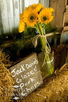"old wood boards are great ways to ""list"" what the catering items are for a country theme wedding reception"