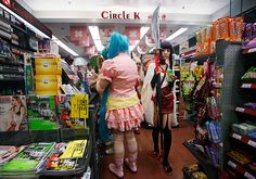Cosplayers hunt for snacks and beverages at a Circle K convenience store during the annual Comics Festival and Game Fair in Hong Kong on July 27, 2012.