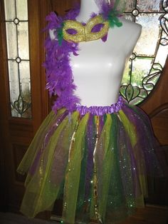 Are you ready for Mardi Gras Parties? This fun adult or teen size purple, gold and green sparkle tutu set will be perfect. The tutu measures 16 long
