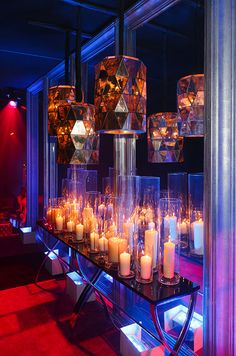 Turn your wedding reception into a nightclub with countless candles and dark decor.