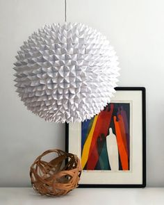 """DIY Paper Origami Chandelier + some other cool DIY lighting ideas including a similar """"orb chandelier"""" made from cupcake wrappers Do It Yourself Couch, Diy Luz, Diy Luminaire, Papier Diy, Diy Light Fixtures, White Pendant Light, White Light, Paper Lanterns, Cool Diy"""