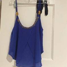 Tank top Blue tank top with gold chain on the top and small chains on the back. Missing one of the chain links in the back and has a small stain on the front. Love Culture Tops Tank Tops