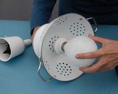 Bored with ordinary lamps in your house? Start the changes with transforming a colander into cool lamp shade.